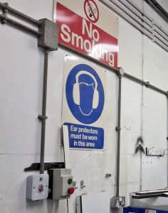 hearing protection sign on a wall