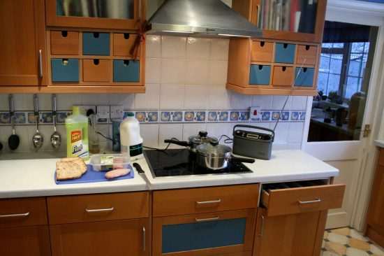 A kitchen with food and cleaning products